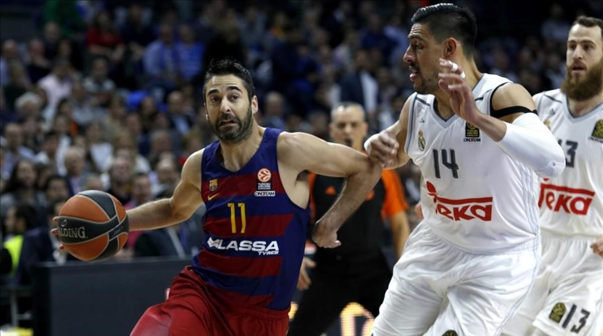 Navarro conduce el balón en presencia de Ayón y Sergio Rodríguez en el partido europeo del pasado enero