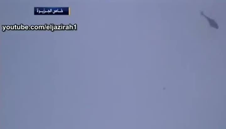 V''ideo de Al Yazira en que se ve como un helicóptero del régimen sirio lanza un barril bomba sobre un hospital en Alepo.