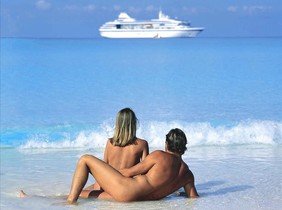tcendros3084400 a nude couple lie on a beach before a luxury liner160330124956