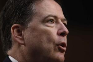 Former FBI Director James Comey testifies before a Senate Intelligence Committee hearing in Washington