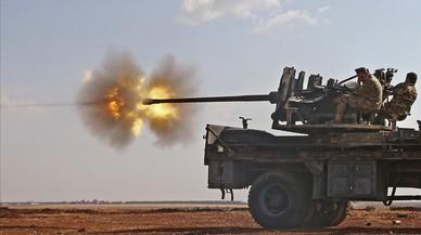 Combatents de l'Exèrcit Lliure de Síria, durant la lluita contra l'Estat Islàmic al poble de Yahmul.