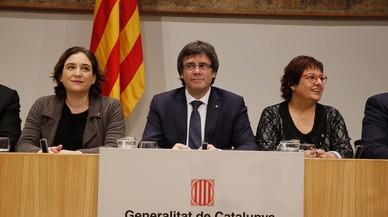 Puigdemont i Colau exigeixen a les elèctriques que firmin un conveni contra la pobresa energètica