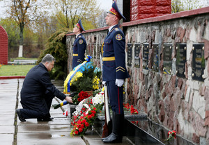 Ukrainian President Poroshenko lays flowers during a commemoration ceremony at a monument to liquidators near the Chernobyl nuclear power plant