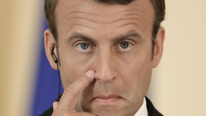 lmmarco39788987 french president emmanuel macron touches his face during a j170824182837