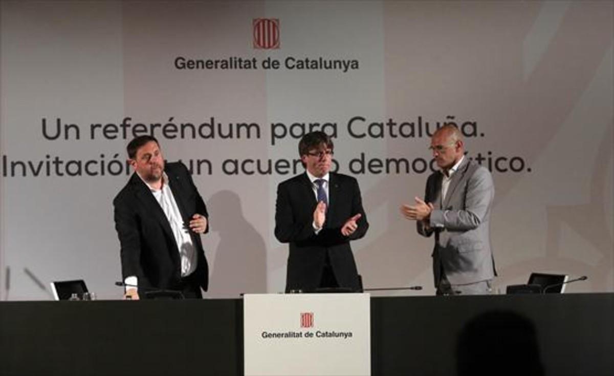 Junqueras, Puigdemont y Romeva, ayer, en la conferencia de Madrid.