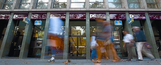 El popular entrar en p rdidas tras sanearse en for Oficinas banco popular barcelona