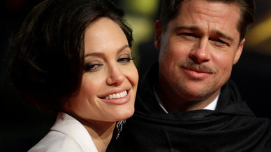 U.S. actor Pitt and his partner Jolie pose for photographers on the red carpet in Berlin