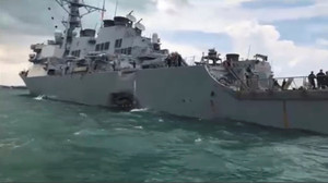 Damage is seen on the U.S. Navy guided-missile destroyer USS John S. McCain after a collision, in Singapore waters in this still frame taken from video