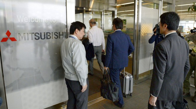 Transport ministry officials arrive at Mitsubishi Motors Corp.'s plant for an on-site inspection in Okazaki