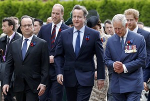 French President Hollande, Britains Prime Minister Cameron, and Britains Prince Charles arrive to attend a ceremony at the Franco-British National Memorial in Thiepval near Albert