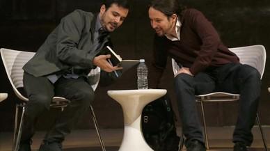 Alberto Garzón y Pablo Iglesias, este viernes, en el debate celebrado en Madrid sobre las confluencias.