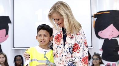 Cifuentes, con el pequeño Yousef, de 9 años.