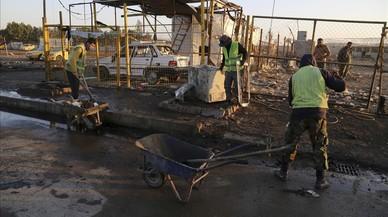 Mig centenar de morts per un cotxe bomba a Bagdad