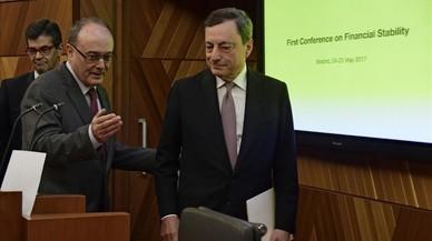 Draghi insta els bancs a retallar més oficines i plantilla