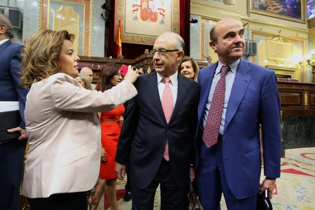 Soraya Senz de Santamara, Cristbal Montoro y Luis de Guindos, en el Congreso para aprobar los recortes.