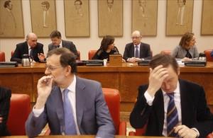 El presidente del PP, Mariano Rajoy, este jueves en la reunión del grupo parlamentario popular en el Congreso.