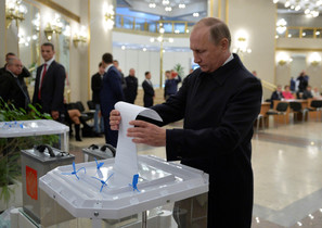 Russian President Putin casts ballot at polling station during parliamentary election in Moscow