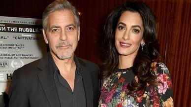 George y Amal Clooney en la presentaicón del documental de Netflix 'Cascos Blancos', del que la fundación Clooney ha sido anfitrión.