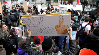 A protester holds an anti-Trump sign as students hold a walk-out in protest to U.S. President Donald Trump's inauguration in Seattle