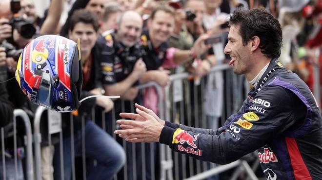 Mark Webber celebra uno de sus podios con el equipo Red Bull.