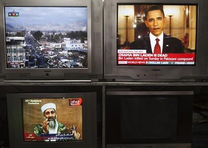 Las imágenes de Osama bin Laden y de Barack Obama, presidente de EEUU, comparten protagonismo en los televisores de una tienda de electrodomésticos de Kabul.