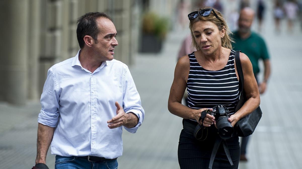 David Armengou y Marcela Miret, autores de la foto del atentado publicada en la mayoría de diarios.