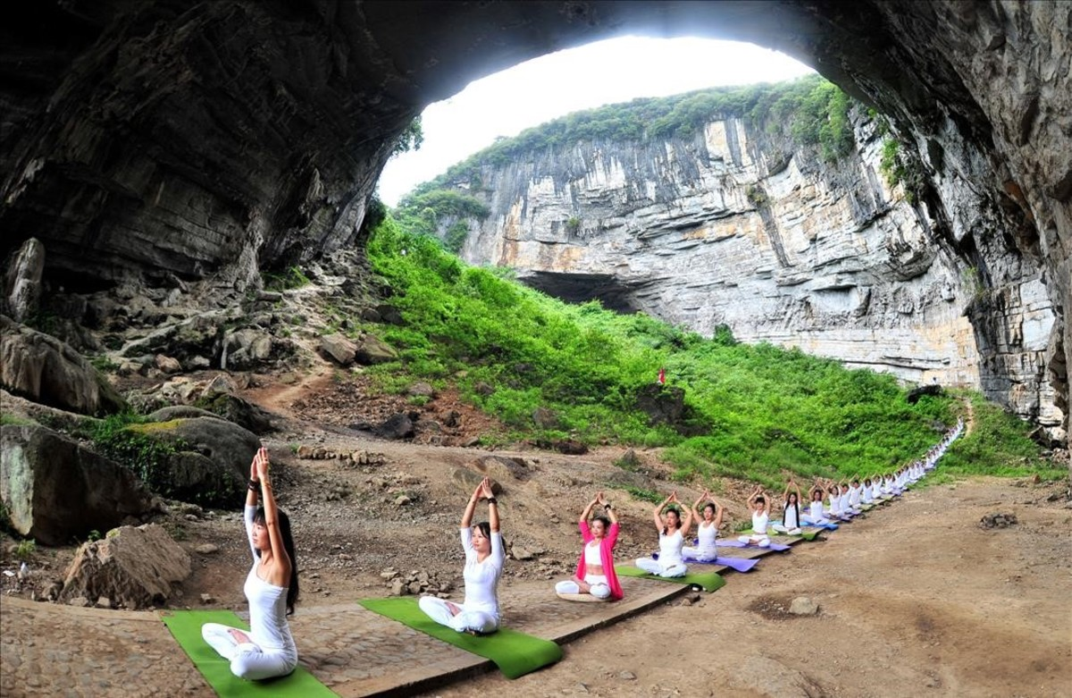 lpedragosa35494813 yoga enthusiasts practice yoga at yueyan cave during a sessi160912223436
