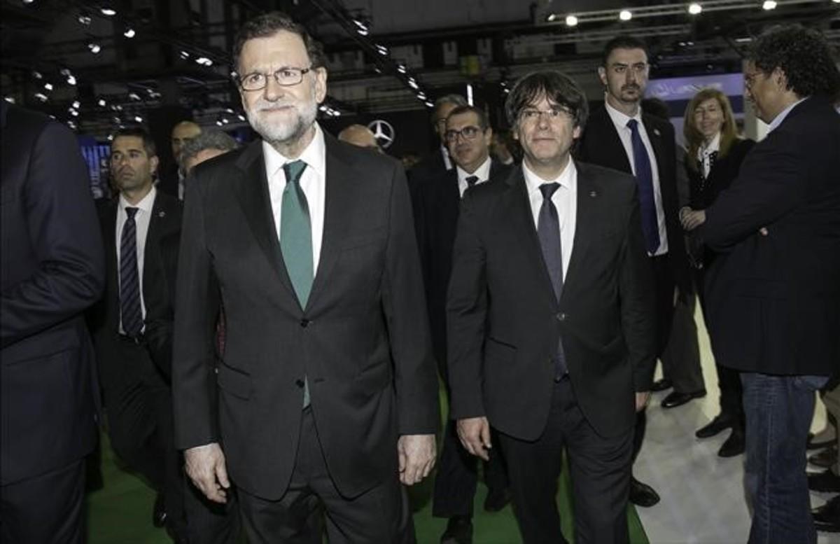 Mariano Rajoy y Carles Puigdemont