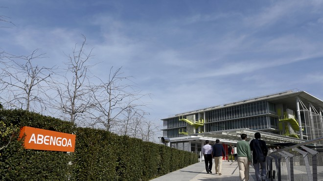 People walk in Campus Palmas Altas, Abengoa's headquarters in the Andalusian capital of Seville, southern Spain