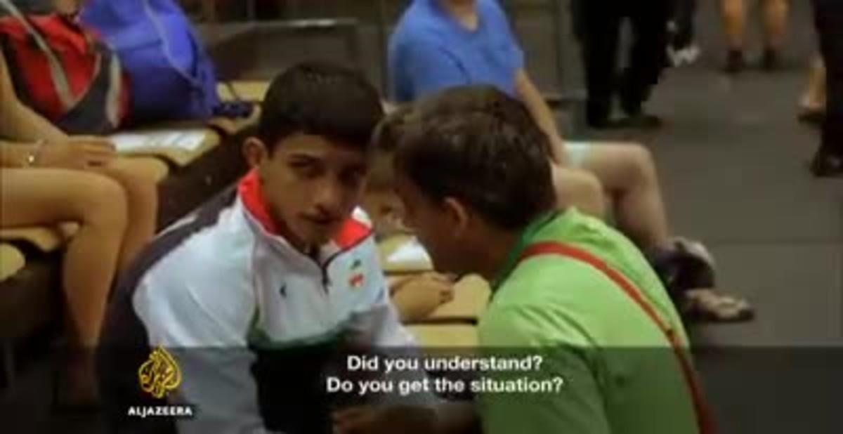 Un lluitador iranià arrenca a plorar quan el seu entrenador l'obliga a fingir una lesió per no enfrontar-se a un israelià