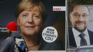 mbenach40196365 a man walks by election posters of german chancellor angela 170923223320