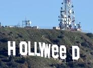 El cartel de Hollywood con las letras cambiadas para celebrar la legalización de la marihuana.