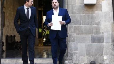 El 'conseller' de Justícia, Carles Mundó, con el vicepresidente del Govern Oriol Junqueras.