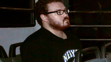 File photo of Jutting, a British banker charged with two counts of murder, sitting in the back row of a prison bus as he arrives at the Eastern Law Courts in Hong Kong