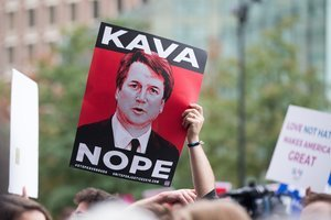 An activist holds a sign at a rally calling on Sen  Jeff Flake  R-AZ  to reject Judge Brett Kavanaugh s nomination to the Supreme Court on October 1  2018 in Boston  Massachusetts  Sen  Flake is scheduled to give a talk at the Forbes 30 under 30 event in Boston after recently calling for a one week pause in the confirmation process to give the FBI more time to investigate sexual assault allegations    Scott Eisen Getty Images AFP