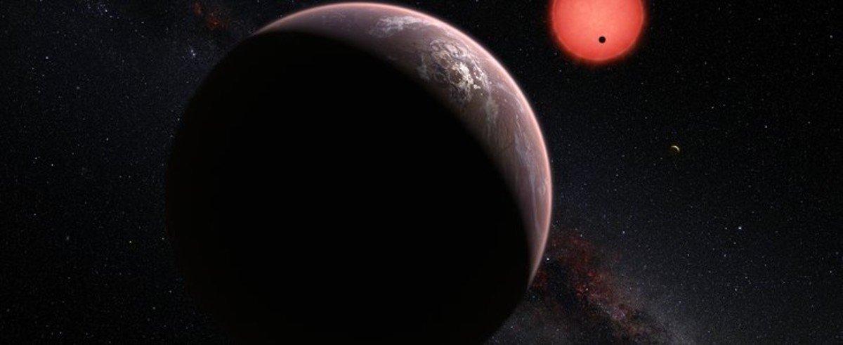Ilustración de la estrella enana ultrafría TRAPPIST-1 y de sus tres planetas