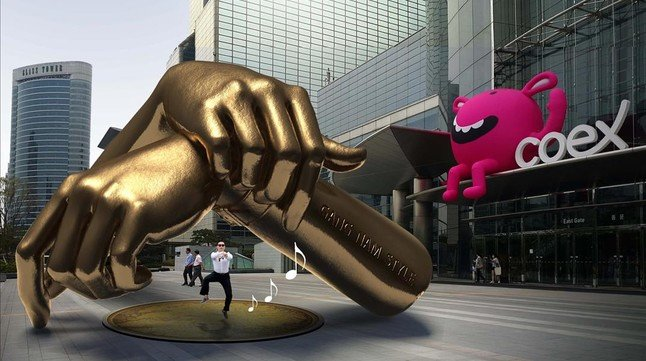 Imagen generada por ordenador que muestra la futura escultura de metal dedicada a Psy y su vídeo de la canción Gangnam style.