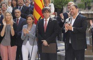 El president, Carles Puigdemont, y el vicepresidente del Govern, Oriol Junqueras, durante el anuncio de la fecha y la pregunta del referéndum.