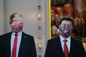A view shows cardboard cutouts, displaying images of U.S. President Donald Trump and Chinese President Xi Jinping, with protective masks widely used as a preventive measure against coronavirus disease (COVID-19), near a gift shop in Moscow, Russia March 23, 2020. REUTERS/Evgenia Novozhenina