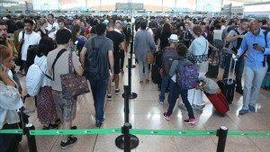 Colas en el aeropuerto de El Prat, el pasado verano.