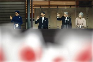 Emperor Akihitowaves to national flag-waving well-wishers with Empress Michiko,Crown Prince Naruhitoand Crown Princess Masako after delivering his speech marking his 85th birthdayhis last birthday on the throneat the Imperial Palace in Tokyo.EFE EPA KIMIMASA MAYAMA