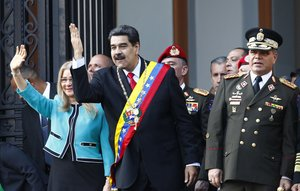 Venezuela s President Nicolas Maduro center and his first lady Cilia Flores wave to supporters as they leave the National Pantheon after attending a ceremony to commemorate an 1800 s independence battle in Caracas Venezuela Wednesday Aug 7 2019 Sweeping new U S sanctions freeze all of the Maduro government s assets in the U S and even threaten to punish companies from third countries that keep doing business with his socialist administration The first couple is accompanied by Defense Minister Gen Padrino Lopez AP Photo Leonardo Fernandez