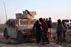 Los integrantes de las Fuerzas Democráticas Sirias combatiendo al Estado Islámico.
