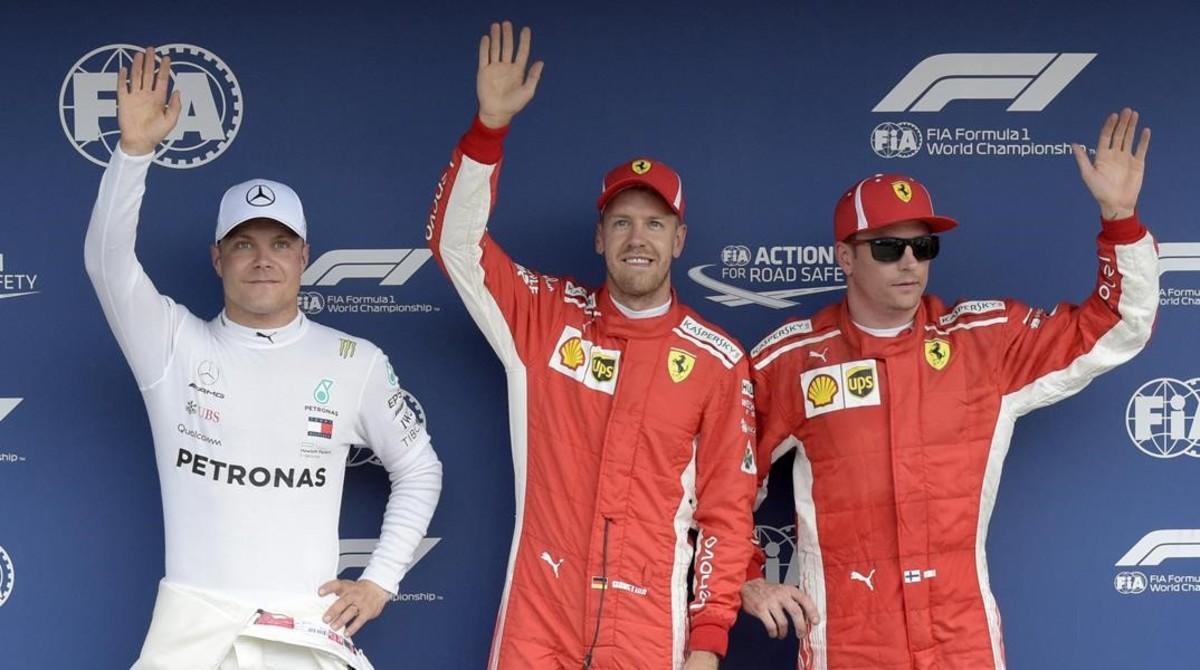 Valtteri Bottas (2º), Sebastian Vettel (1º) y Kimi Raikkonen (3º), después de marcar la pole del GP de Alemania.