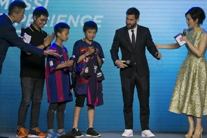 barcelona s lionel messi second right meets young football180216172909