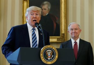 FILE PHOTO U S President Donald Trump speaks during a swearing-in ceremony for new Attorney General Jeff Sessions R at the White House in Washington U S February 9 2017 REUTERS Kevin Lamarque File Photo