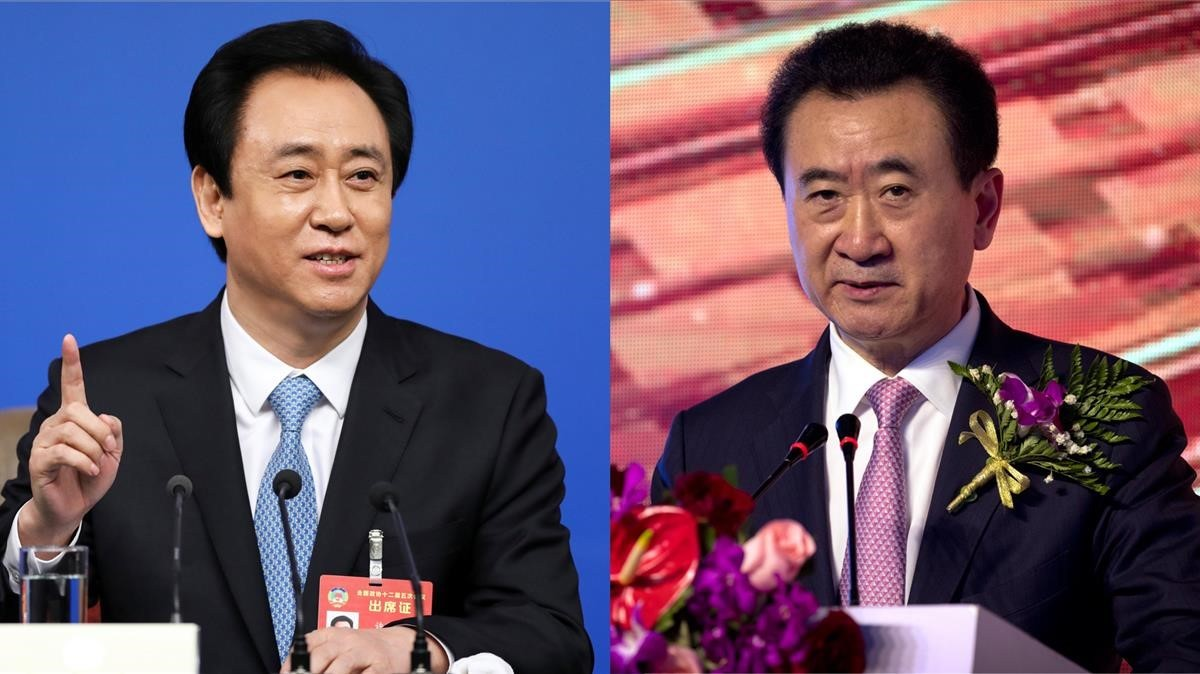 A la izquierda Xu Jiayin,dueño de Evergrande y a la derecha Wang Jianlin, propietario de Wanda.