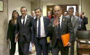 Josep Rull, Jordi Sánchez y Jordi Turull, tras recoger su acta de diputado.