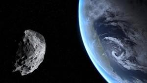 Simulación de un asteroide pasando cerca dela Tierra.