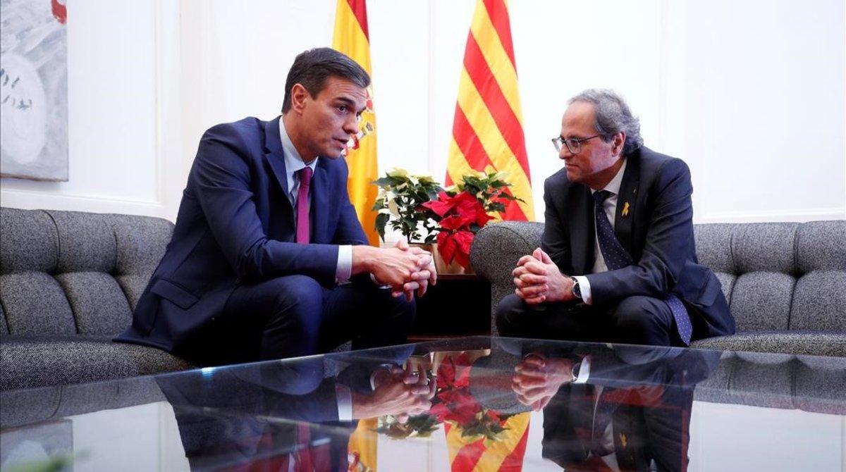 Pedro Sánchez y Quim Torra en el encuentro en Pedralbes (Barcelona), el 20 de diciembre del 2018.